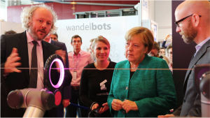 Chancellor Angela Merkel visiting ComNets Demo